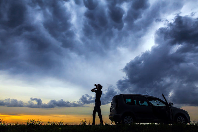 Photographer silhouette taking pictures of spectacular and dramatic evening sky with Mammatus clouds landscape Dramatic Sky Landscape_Collection Man Nature Stormy Weather Sunset Silhouettes Sunset_collection Taking Pictures Travel Boy Car Clouds Dramatic Dramatic Landscape Landscape Outdoors Overcast Photographer Photography Power In Nature Shiluette Sky Storm Cloud Storm Clouds Sunset