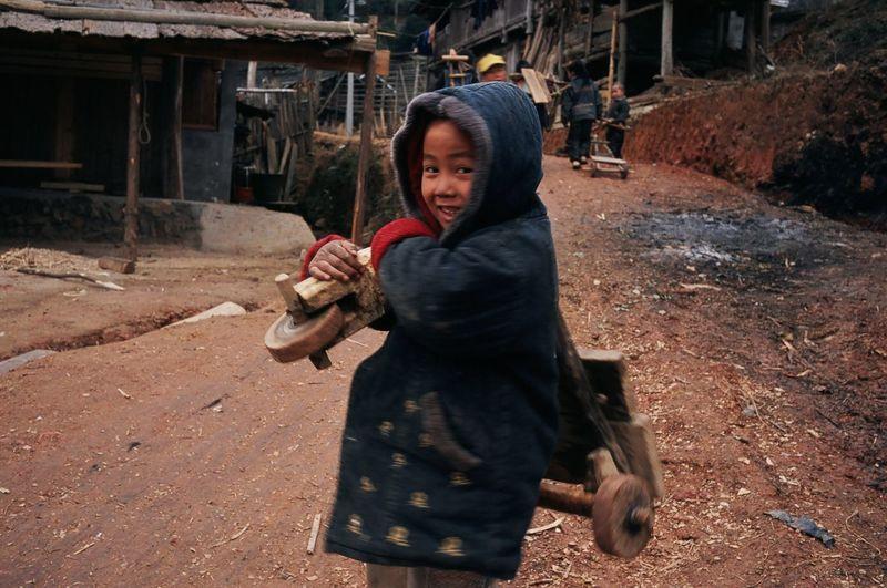 Portrait of happy boy holding camera