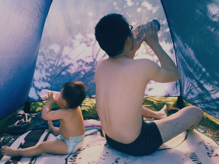 Enjoy The New Normal Love Daddy's Girl Daddy Daughter Time Baby Drinking Enjoying Life Camping Summer Always Be Cozy Two People Family Togetherness My Year My View