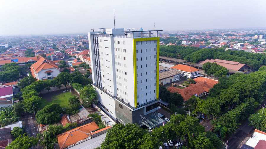 Tall buildings in the city of Surabaya Building Exterior Architecture Built Structure City Tree Building Plant High Angle View Residential District Nature Day No People Cityscape Street Road Outdoors Transportation Sky Tower TOWNSCAPE Luxury Buildings Metropolis Buildings & Sky House