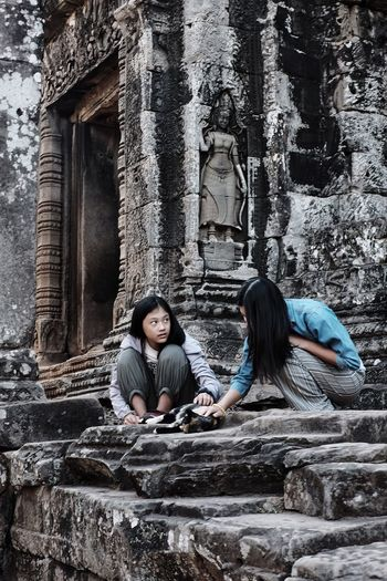 The Great Outdoors - 2017 EyeEm Awards Two People Sisters Stones Cat Cat Lovers Temple Cambodia Angkor Girls Lookingup People Photography People Architecture Architecture_collection Sacred Places