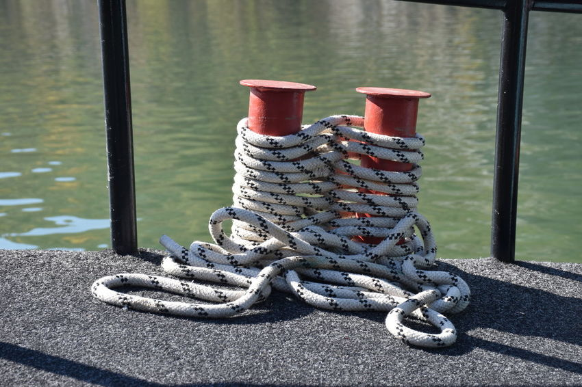 Day Metal Water No People Tied Up Nature Rope Outdoors Strength Focus On Foreground Sunlight Security Safety Transportation Ship River Shadow