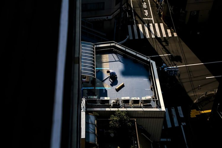 Low angle view of man and buildings in city