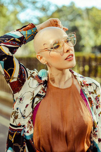 Midsection of woman wearing sunglasses