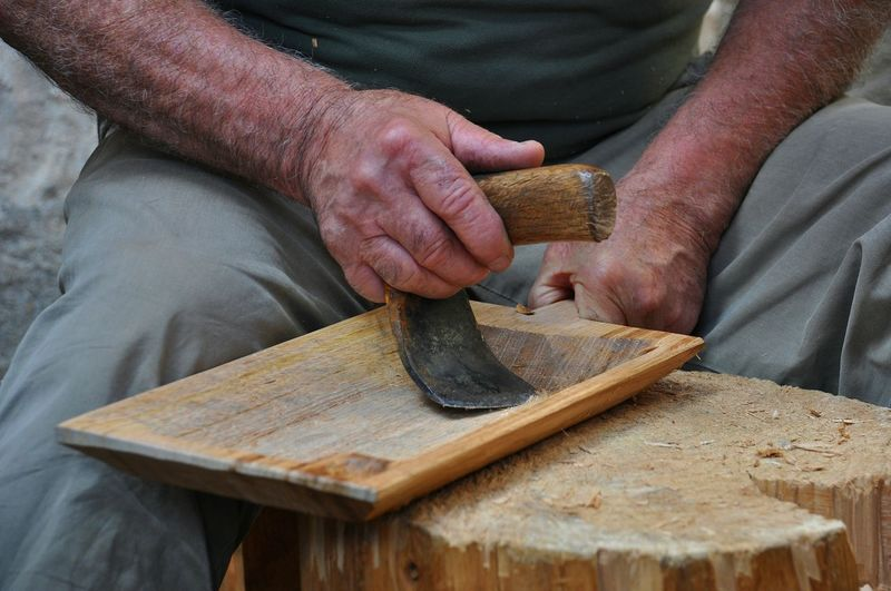 Skill  One Person Human Hand Adults Only Craftsperson Midsection Indoors  Adult Human Body Part One Woman Only Carving - Craft Activity Working Workshop Close-up Carpenter People Day Carpentry Only Women Instrument Maker Sardinia
