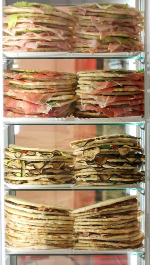 Refrigerator with lots of stuffed sandwiches called Spianata or Piadina in Italian language for sale #Food #italian Food #italianfood #food #foodsex #foodie Bologna Piadina A Lot Of People Bar Catering Service Display Cabinet Food Indoors  Italian Food Large Group Of Objects Many No People Piadina Romagnola Piadinaromagnola Refrigerator Restaurant Retail  Shelf Shopping Mall Spianata Variation Windows_aroundtheworld