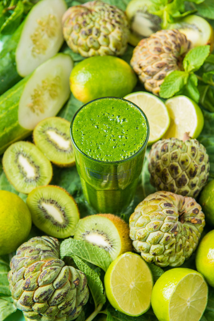 green color, food and drink, freshness, healthy eating, fruit, lime, slice, food, refreshment, variation, high angle view, indoors, no people, close-up, drink, day