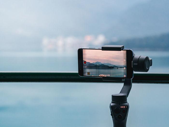 Close-up of smart phone on tripod