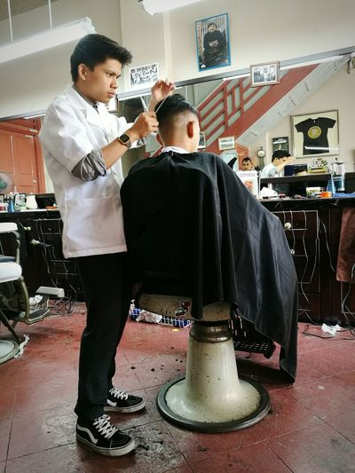 Relaxing Take A Break Barbershop Barberlife Barberstyle Malaysianbarber Penangbarber Razorfade Pompadour SlickbackSenior barber with client