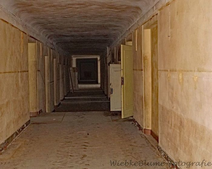 Lost Places Absence Arcade Architectural Column Architecture Building Built Structure Ceiling Colonnade Corridor Day Diminishing Perspective Direction Empty History Indoors  No People The Past The Way Forward vanishing point Wall - Building Feature Wood - Material