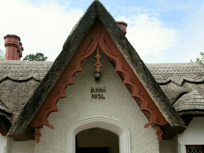 Thatched cottage Thatched Cottage Thatched Roof Thatch Thatched Chimneys Front Porch 19th Century Killarney  County Kerry Ireland