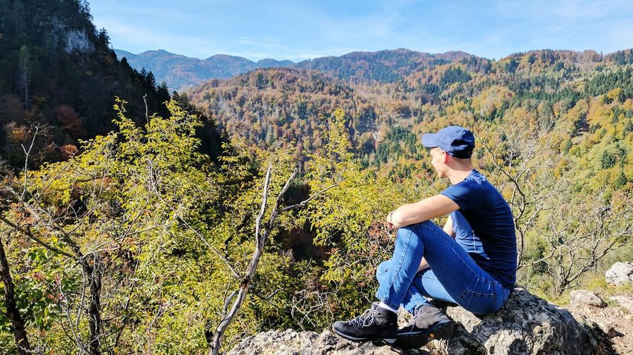 Adult Adults Only One Person Only Men People One Man Only Mature Adult Men Outdoors Working Day Baseball Cap Nature Slovenia Sitting Adults Only Adult Hiker Mountains Casual Clothing Beauty In Nature Sky Travel Destinations Rear View Perspectives On Nature