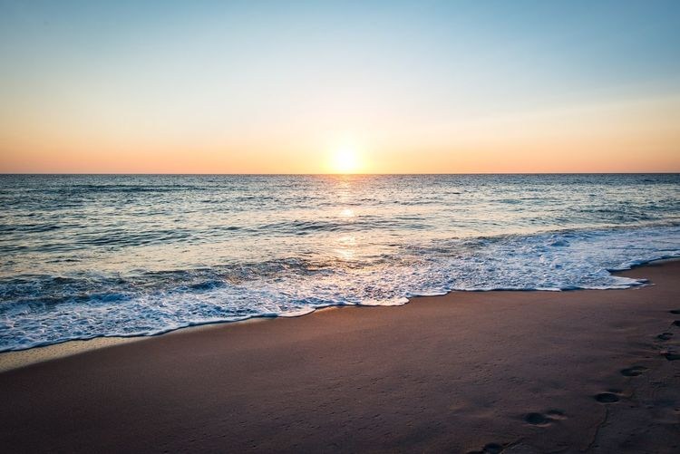 Sea Horizon Over Water Sunset Scenics Beauty In Nature Beach Nature Tranquil Scene Tranquility Water Clear Sky Sand Wave Idyllic Sky No People Sun Sunlight Outdoors Horizon