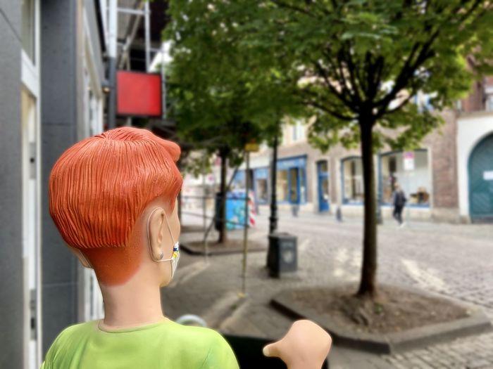 Rear view portrait of boy in park