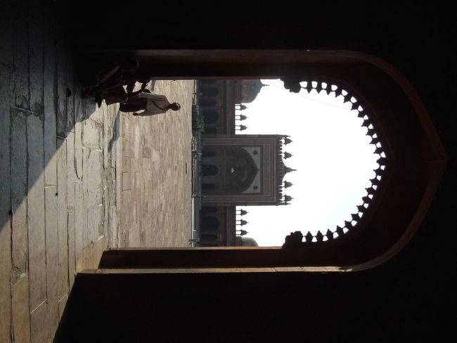 Figure in the arch...silhouette in silhouette Agra Agriculture Architecture Architecture Building Exterior Built Structure Buland Darwaza Courtyard  Day Fatehpur Sikri Human Silhouette India Lone Flower  Mughal Architecture Ornamental Arch Outdoors Sands Sandstone Silhouette Stonework Through The Arch Travel Destinations