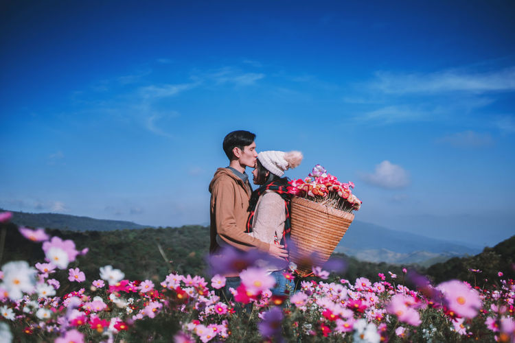Years come and go but what will remain unchanged is my feelings for you.❤❤❤ Happy New Year 2019 flowering plant. Cute young couple in love in pink flower garden. Mountain Christmas Celebration Flower Head Outdoors Growth Three Quarter Length Land Adult Casual Clothing Women Day Cloud - Sky Lifestyles Container Freshness Real People Nature Sky Basket One Person Beauty In Nature Plant Flower Flowering Plant