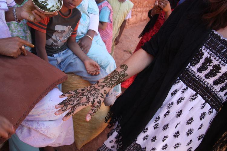 Woman Applying Henna Tattoo