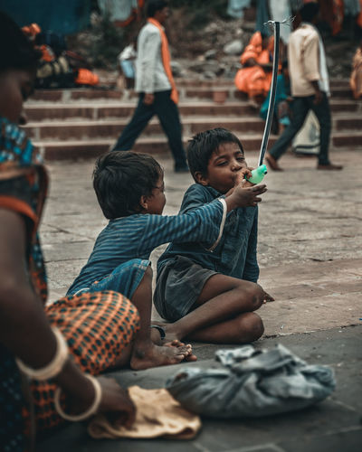 childhood Children Photography Children Only The Street Photographer - 2019 EyeEm Awards Streetlife Streetphotography Street Photography Child Childhood Sitting Friendship Full Length Boys Males  Girls Togetherness Females Sibling Brother Family With Two Children
