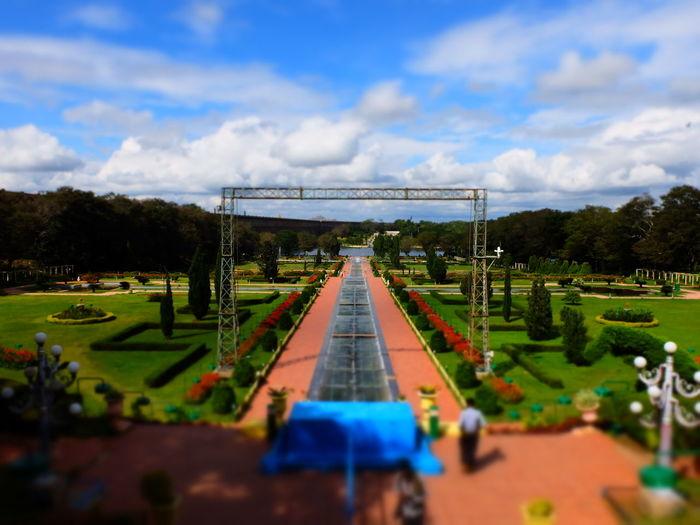 Tilt-shift image of park against sky