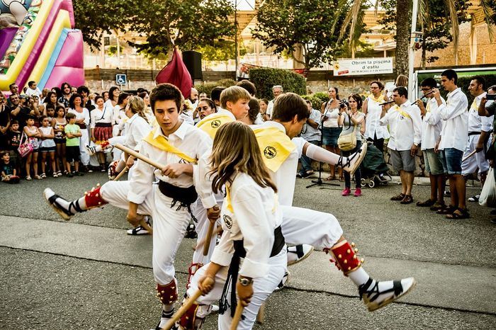 Ball de bastons (Catalan pronunciation: [ˈbaʎ də βəsˈtons], stick dance) is the name of a ritual weapon dance spread throughout Europe and the rest of the Iberian area (cossiers in Majorca, Portuguese pauliteiros, Aragonese palotiau, Basque ezpatadantza and Spanish paloteo ortroqueado) but mostly in Catalonia. English and Welsh Morris dances are well-known relatives to these traditions. The origins of dance are difficult to reference; first recorded mention dates to 1150, in a banquet of Count Berenguer IV) Most melodies are based on easy 2/4 rhythms. Instrumentarium includes tabor pipe, shawm or bagpipes. Some of these tunes as Villano de Zamora were strikingly popular grounds among European Renaissance and Baroque composers. Various different traditions are encompassed in the phrase, but normally the dancers will all carry one or two sticks (bastons) traditionally of holm oak, about 40–50 cm long and 5 cm thick. In the most common set, two opposite rows of dancers elaborate some patterns of stick-clashing. Sometimes, a peculiar chief character directs the movements and changes. The dancers may wear white skirts or short trousers, as well as red ribbons and ornaments. Traditional Clothing Color Popular Culture Traditions Open Edit Stick Dance Ball De Bastons