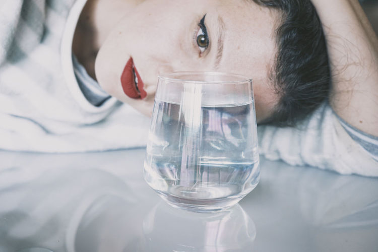 Portrait of man drinking water in glass