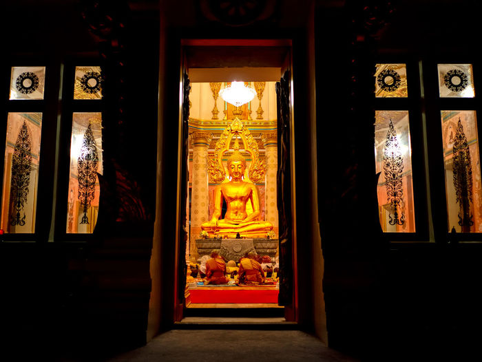 View of buddha statue in illuminated building