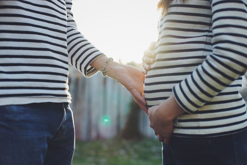 Baby Midsection Striped Togetherness Two People Bonding Real People Women Casual Clothing Couple - Relationship Positive Emotion Men Love Holding Hands Focus On Foreground People
