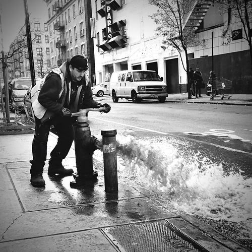 """Dirty water"" B&w Street Photography Photography New York Streetphotography NYC Stopandlookaroundyou Washington Heights Manhattan Worker Water Blackandwhite Showcase: December Shootermag EyeEm Best Shots - Black + White"