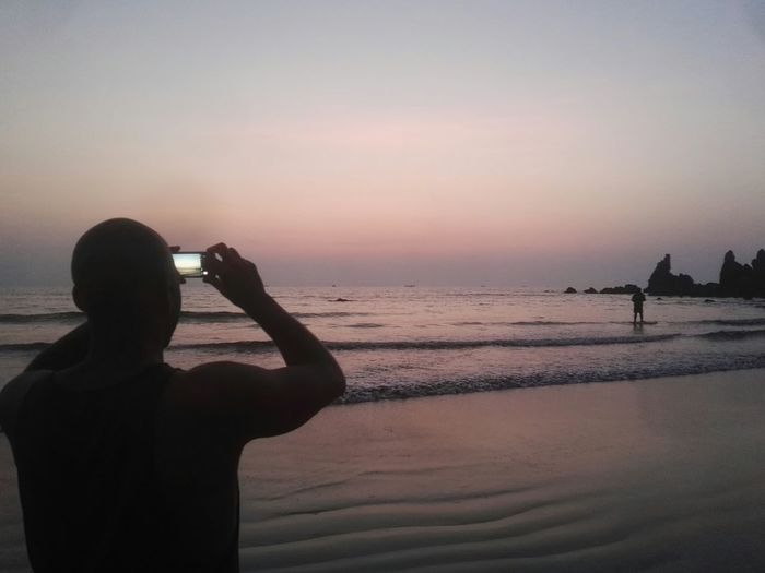 Landscape Goa India. Love Tranquility Scenics Only Men Sea Shadow Silhouette Sunset People One Person Water Leisure Activity Beauty In Nature Men Beach Arambol Beach Goa Arambol Beach