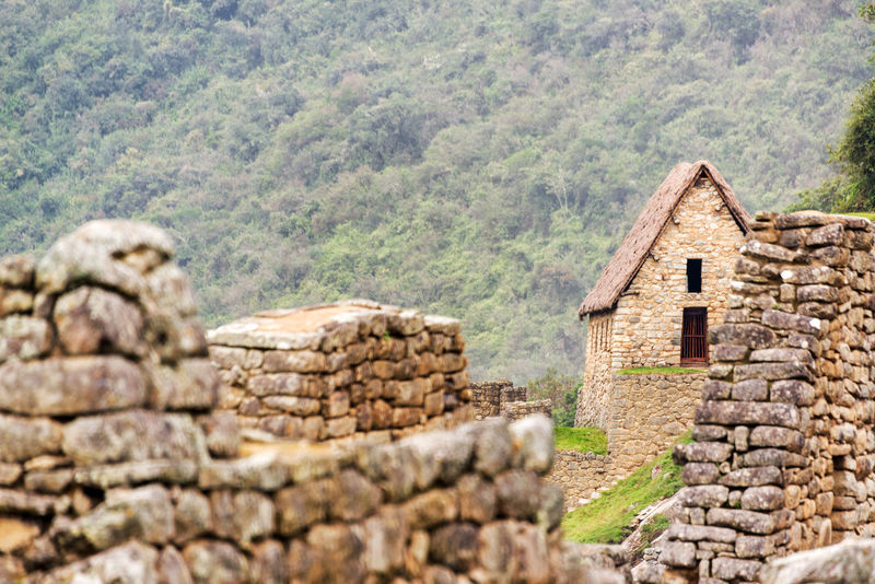 View of a building with an intact roof at the ruins of Machu Picchu, Peru Ancient Andes City Cusco Cusco, Peru Cuzco Destination Famous Historic Inca Landscape Lost Machu Picchu Mountain Nature Outdoors Peru Ruin South America Tourism Travel Unesco Valley World Heritage World Wonder