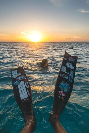 🌅 Swimming with the setting sun 🌅~ Grandturk Turksandcaicos Sony Godscreation Beauty In Nature Freediving Female Tropical Climate Scuba Diving Snorkeling Adventure Swimming Travel Destinations Vacations Water Exploration Sea Fins Freediver Sunset