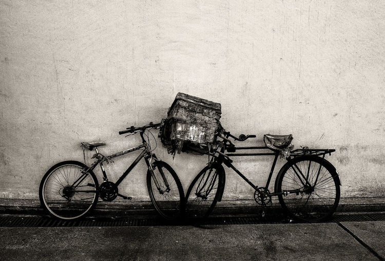 Bicycles parked against wall