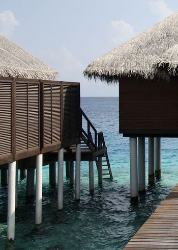 water village in Indian Ocean, maldives Architecture Beach Beauty In Nature Color Colors Design Holiday Horizon Over Water Life Light Maldives Nature Outdoor Outdoors Pier Sea Sky Stairs Stilt House Thatched Roof Travel Water Watervillage Wooden