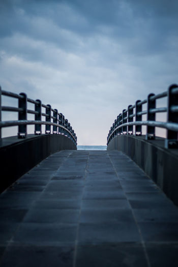 View of pier against cloudy sky