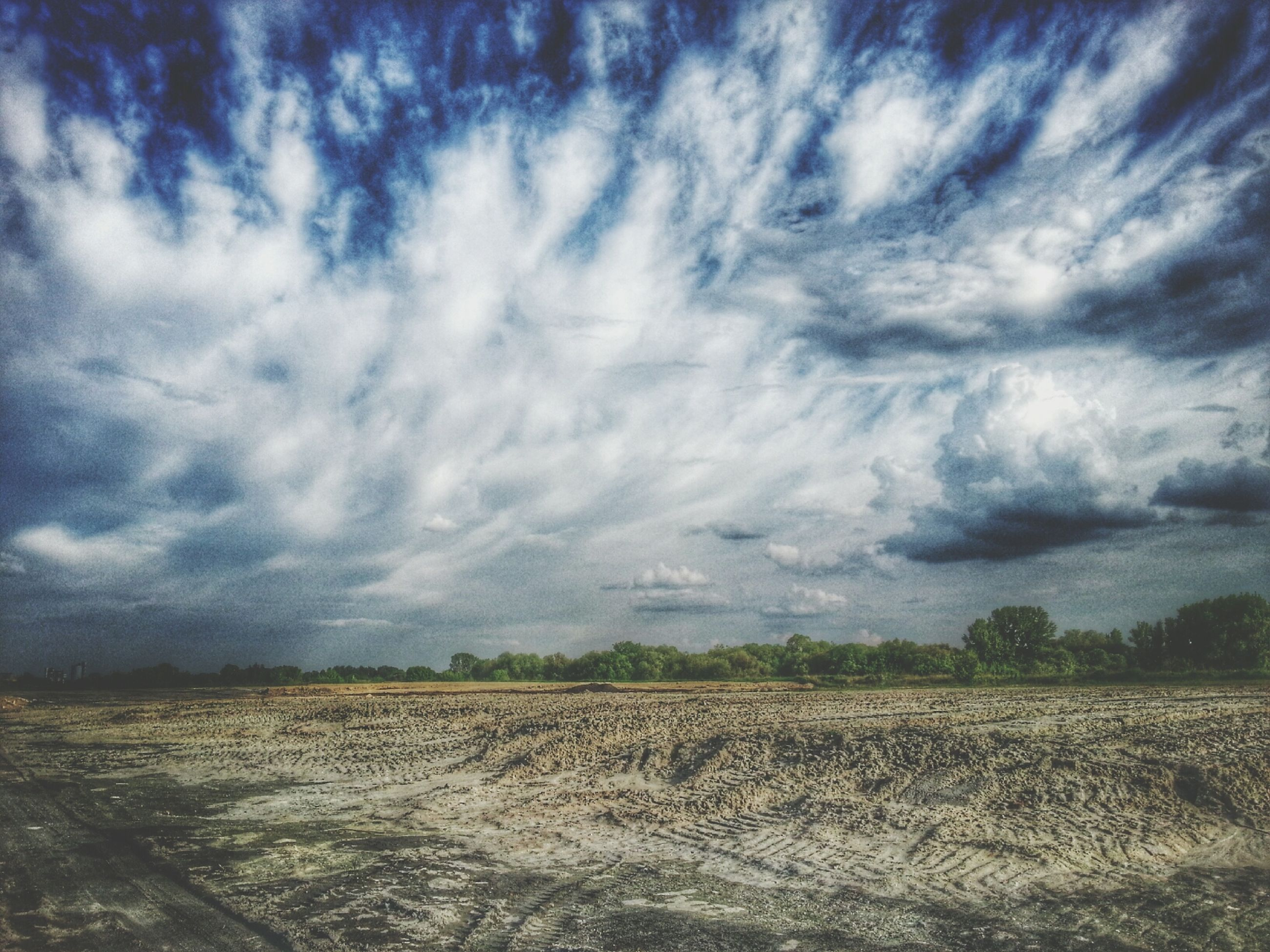 sky, landscape, cloud - sky, tranquil scene, tranquility, field, cloudy, scenics, agriculture, rural scene, beauty in nature, nature, cloud, farm, growth, weather, non-urban scene, horizon over land, grass, idyllic