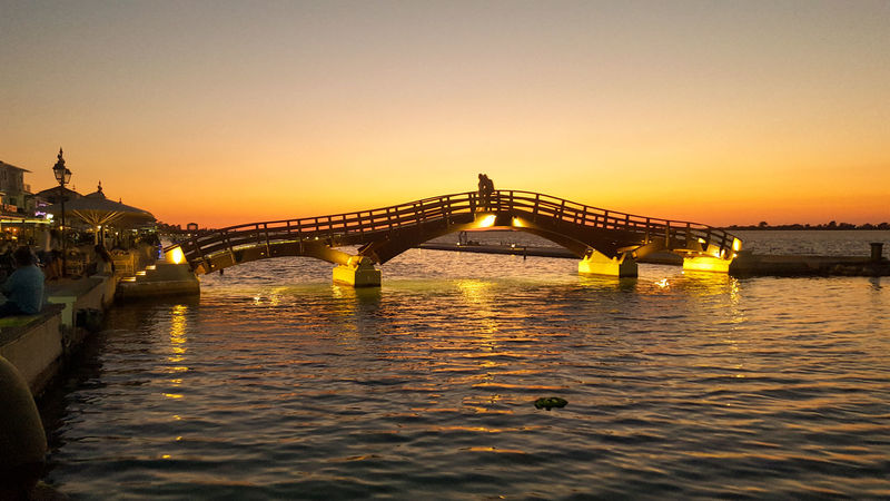 Sunset Bridge Night Water Travel Destinations Vacations Architecture Outdoors Sea Cityscape Illuminated Orange Sunset Lefkada Lefkas Greece Port Silhouette River Harbour Harbor Marina Orange Color Connection Let's Go. Together. Paint The Town Yellow See The Light