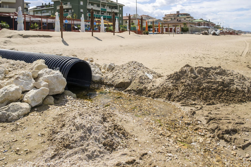 Drains into the Sea Architecture Beach Built Structure Cloud Cloud - Sky Danger Day Dirty Drain Drainpipe Environment Environmental Pollution Nature No People Outdoors Pipe Pollution Pollution In My World Sand Sea Sealife Sky Surface Level