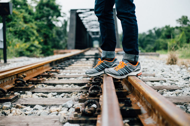 Casual Clothing Chill Leisure Activity Lifestyles Nature Outdoors Railroad Track Relaxing Sportshoes Surface Level