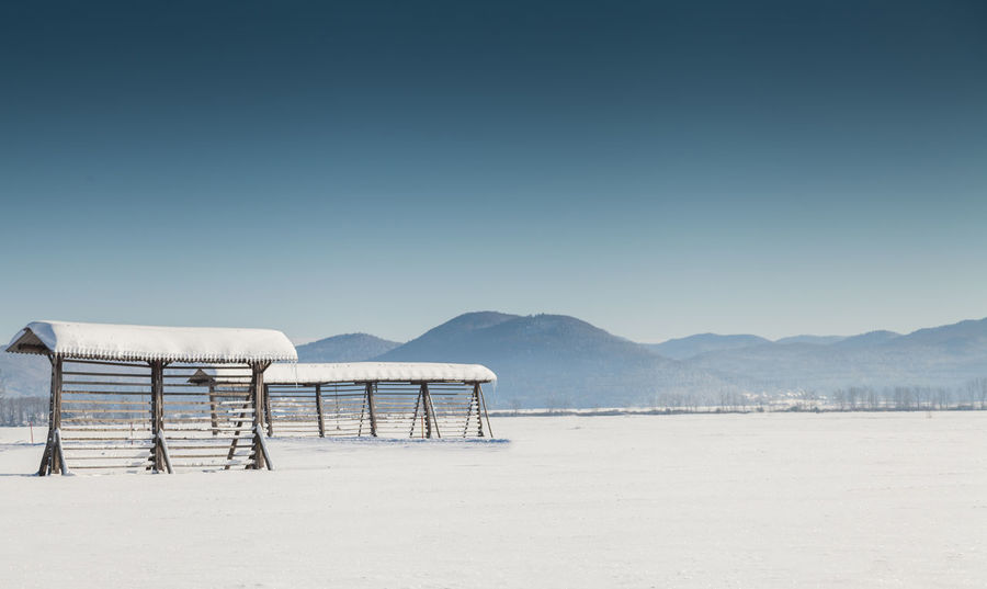 Shades Of Winter Slovenia Slovenia Scapes Beach Beauty In Nature Blue Clear Sky Day Landscape Mountain Nature No People Outdoors Sand Scenics Sky Tranquil Scene Tranquility Water
