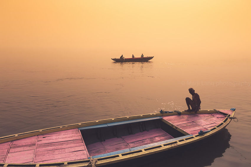 Atmospheric Mood Boat Boats Composition Dreamy Ganges India Marji Lang Photography Mist Misty Mode Of Transport Nautical Vessel One Man Orange Color Pastel Colors River Silhouette Sunset Transportation Travel Travel Travel Photography Varanasi Water Feel The Journey