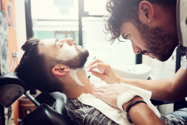 Traditional ritual of shaving the beard in a old style barber shop. Barber Shop Barbershop Vintage Style Barber Barber Pole Barberlife Beard Body Care Close-up Day Indoors  Lifestyles Mammal Men Occupation People Shaving Two People Vintage Working Young Adult