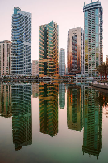 Sunset in Dubai Dubai Dubai❤ JLT Reflection UAE UAE , Dubai Architecture Building Exterior Built Structure City Day Dubaicity Dubaimarina No People Outdoors Reflection Reflection_collection Reflections Reflections In The Water Sky Skyscraper Sunset Symmetry Water Waterfront