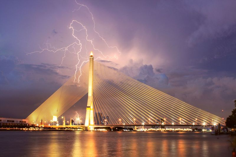 lighting on the bridge @travel Bridge - Man Made Structure Bridge Lighting Thunder Thunderstorm Night Architecture Built Structure Illuminated Bridge - Man Made Structure Connection Suspension Bridge Sky River Urban Skyline Water Outdoors Long Exposure