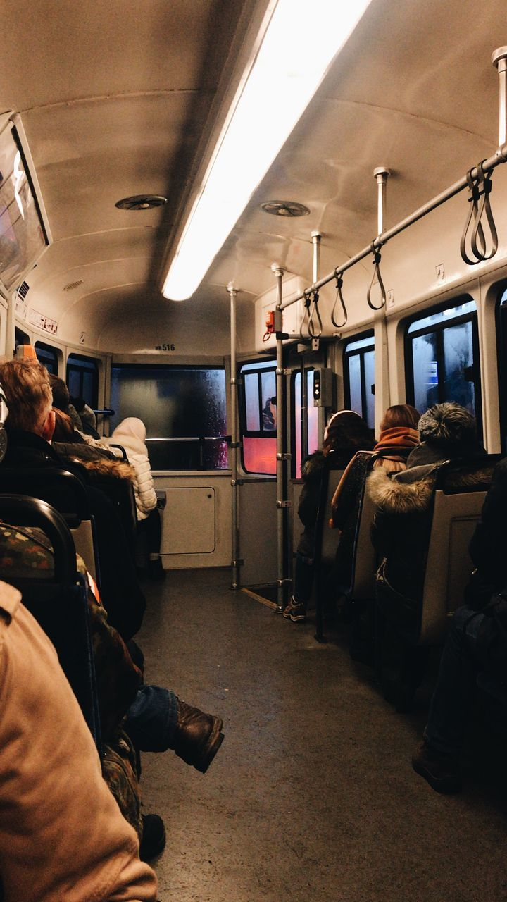 PEOPLE SITTING AT TRAIN