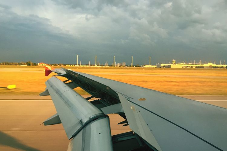 Airplane Sky Transportation Cloud - Sky Air Vehicle Airport Aircraft Wing Mode Of Transport Travel Runway Airport Runway Flying No People Day Outdoors Jet Engine Wind Turbine Commercial Airplane Airplane Wing Nature