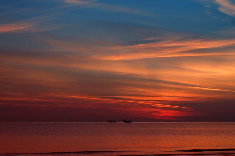 Sunrise Fishing Boat Travel Travel Destinations Sky Water Sunset Beauty In Nature Sea Scenics - Nature Cloud - Sky Tranquility Orange Color Tranquil Scene Horizon Over Water Horizon Transportation Nature Silhouette Idyllic Nautical Vessel Dramatic Sky No People