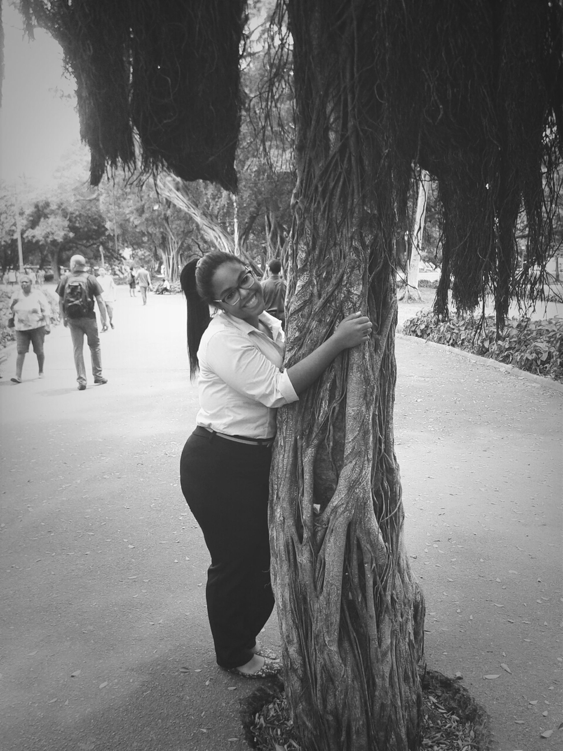 tree, lifestyles, casual clothing, rear view, leisure activity, full length, childhood, walking, tree trunk, standing, day, park - man made space, boys, outdoors, person, girls, footpath