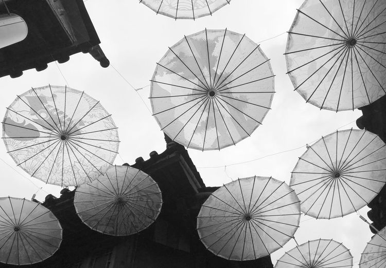 Low Angle View Of Umbrellas For Decoration Against Sky