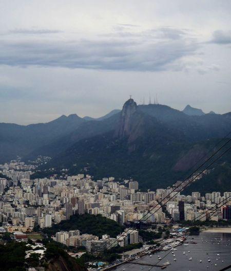 Rio de Janeiro aos pés do Cristo Redentor! #byandrearochael Mountain Architecture Building Exterior Cloud - Sky Built Structure Cityscape No People