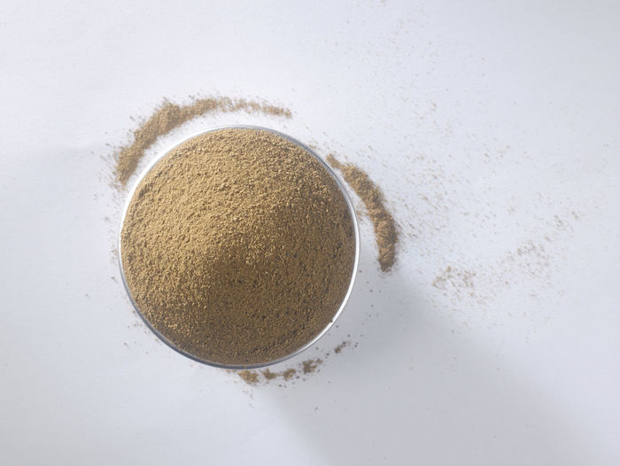 cinnamon powder on the white background Container Food And Drink Nature Brown Cinnamon Powder Cinnamon Sticks Circle Close-up Condiment Copy Space Directly Above Flavor Food Geometric Shape Ground - Culinary High Angle View Indoors  Ingredient No People Seasoning Still Life Studio Shot Top View White Background White Color